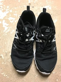 pair of black Adidas low-top sneakers Winnipeg, R3B 2M2