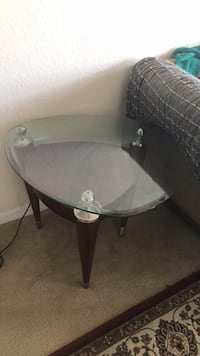 round clear glass-top table with gray steel base Orlando, 32839
