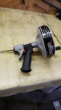 black and gray Ridgid power tool