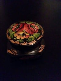 black, red and pink ceramic vase with lid