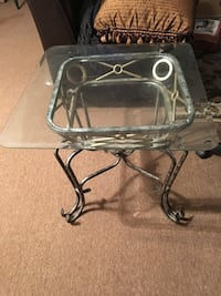 A set of two end tables with a matching coffee table. Selling as a complete set