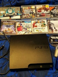 Sony PS3 slim console with game cases Brampton, L6V 3K4