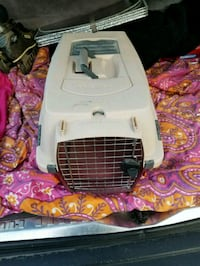 pink and white pet carrier
