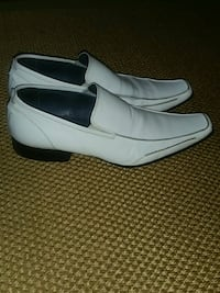 pair of white leather loafers 757 mi