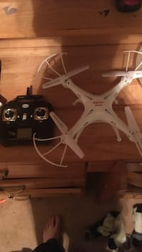 White quadcopter drone with remote Halifax