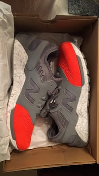 pair of red-white-and-gray New Balance running shoes with box