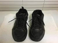 pair of black athletic shoes Nike