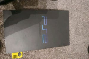 Playstation 2 (fat) with controller/games