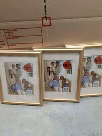 three assorted photo frames with brown wooden frames Vancouver, V5X 3X6