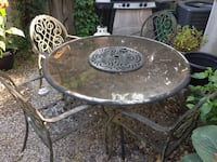 Patio table and 4 chairs. wrought iron... glass top table with lazy susan. finish is cracking and needs a coat of tremclad. Burlington, L7N 2S5