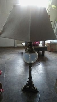 white and brass table lamp with white cone shade