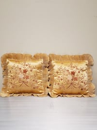 TWO (2) SMALL, GOLD-COLORED SATEEN THROW PILLOWS. Arlington, 22204