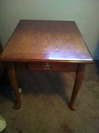 square brown wooden single-door side table