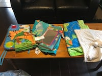 Miscellaneous baby items. Includes crib piano, baby mirror, two floor mats and toys. Brampton