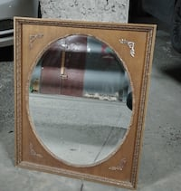 Vintage looking mirror set in resin/ hard plastic.
