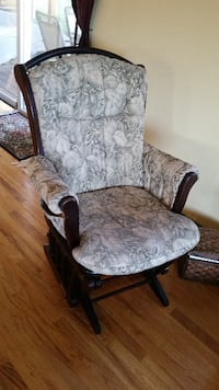 brown wooden framed gray floral padded glider chair