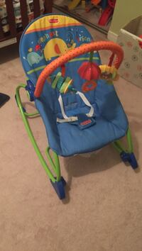 Baby's blue and multicolored fisher-price bouncer
