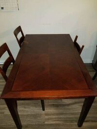 rectangular brown wooden table with chairs Silver Spring