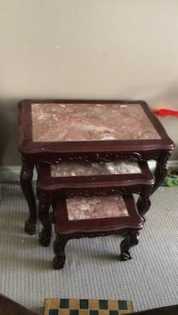 Three stack red marble table
