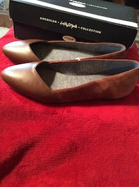 Women pair of new copper brown flats size 9 medium.  Oxon Hill, 20745