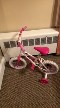 toddler's pink and white bicycle Southington, 06489