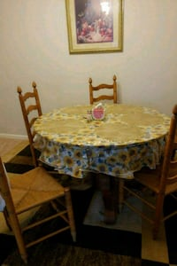 round brown wooden table with four chairs dining set Manassas, 20109