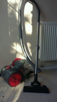 black and red canister vacuum cleaner 5949 km