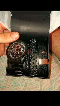round black chronograph watch with black leather strap Norman, 73071