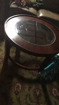 round brown wooden framed glass top coffee table Plymouth, 02360
