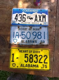 3 blue and yellow license plates