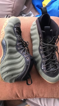 gray-and-black Nike Air Foamposite shoes