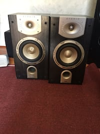 two black and gray speakers