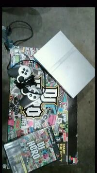 white Xbox One console with controller and game cases Turlock, 95380