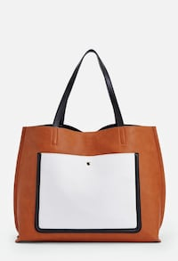 brown,black, and white tote bag