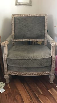 Olive green fabric padded armchair