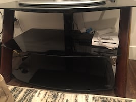 Black glass top tv stand **PICK UP ONLY**