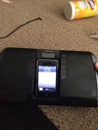 iPod Touch and black dock speaker