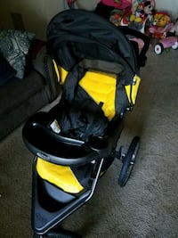 baby's black and yellow jogging stroller 47 km