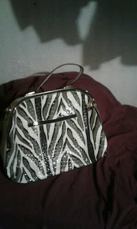 gray and black zebra-printed leather tote bag