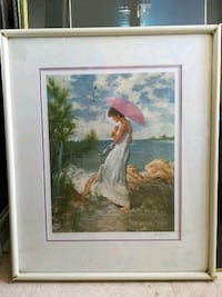 woman in white dress painting with white wooden frame Welland, L3B 5N5