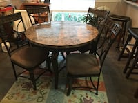 round brown wooden table with four chairs dining set 43 km