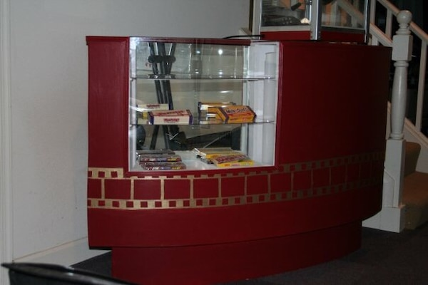 Red and white wooden display cabinet