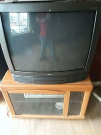 brown wooden TV stand with gray CRT television Nashville, 37138