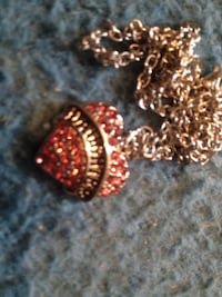 gold-colored red gemstone encrusted heart chain necklace