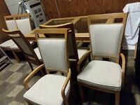two brown wooden framed white padded armchairs Jefferson City