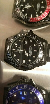round black Rolex analog watch with silver link bracelet Toronto, M6K 3S2