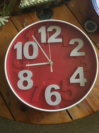 round red and white analog clock