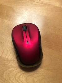 Red Logitech wireless mouse