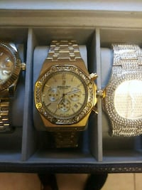 round gold chronograph watch with gold link bracelet in box San Antonio, 78228