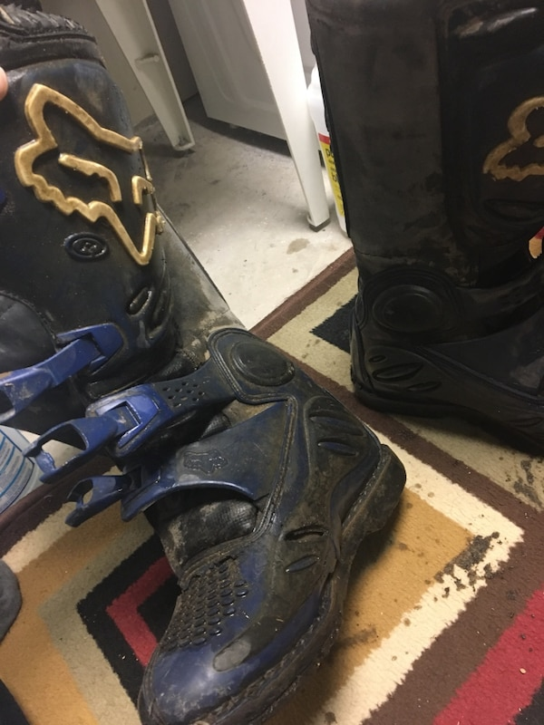 pair of blue-and-black Fox racing boots